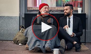 Homeless man with a business guy chatting sitting on the street