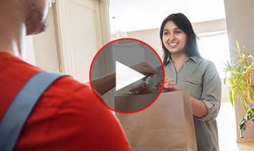Woman receiving a package at her home