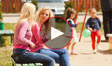 Two mothers talking at a playground