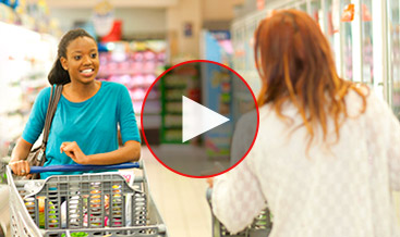 African american woman making conversation with a mother at the supermarket