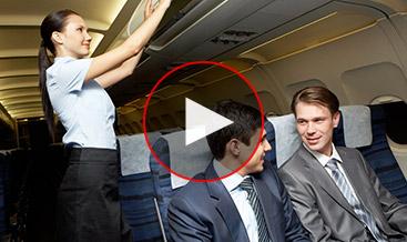 Two men at a plane having conversation