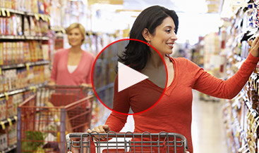 Two women at the supermarket in the cereal aisle